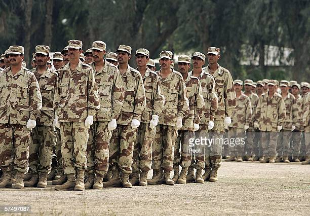 Soldiers from the first entirely Sunni basic training class stand during a graduation ceremony on April 30 2006 in Habaniyah 80 kilometers west of...