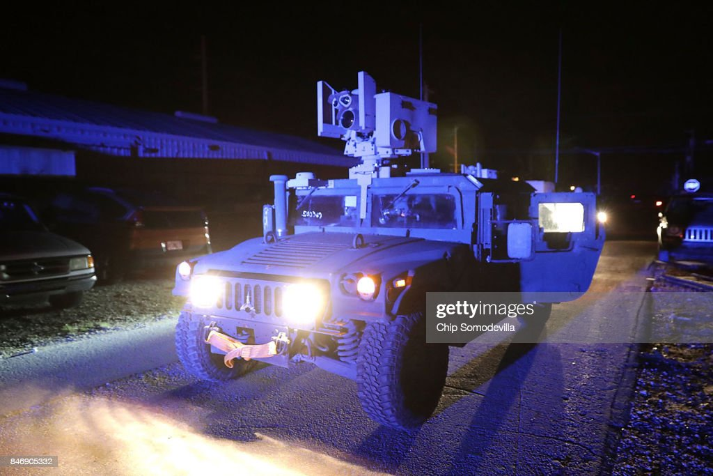 Soldiers from the Florida National Guard's Delta Company, 1st Battallion, 124th Infantry, 53rd Infantry Brigade Combat Team patrol areas for suspected looters using Common Remotely Operated Weapon Station (CROWS) optics systems four days after Hurricane Irma September 14, 2017 on Stock Island, Florida. The unarmed CROWS cameras allow soldiers to see long distances using nightvision, infrared and other enhanced visual tools. Many places in the Keys still lack water, electricity or mobile phone service and residents are still not permitted to go further south than Islamorada. The Federal Emergency Managment Agency has reported that 25 percent of all homes in the Florida Keys were destroyed and 65 percent sustained major damage when they took a direct hit from Hurricane Irma.