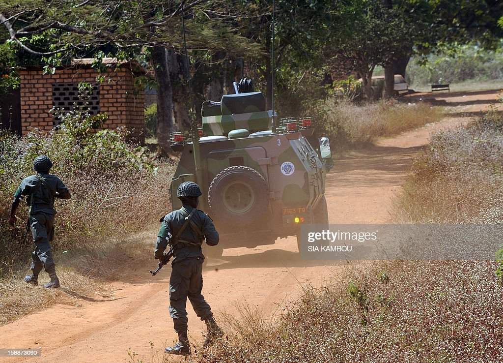 Soldiers from the FOMAC multinational force of central African states man a position near Damara between the 'red line' separating regular army soldiers of the Central African Republic and rebels from the SELEKA coalition, on January 2, 2013. The commander of the multinational African force FOMAC warned rebels in the Central African Republic against trying to take the key town of Damara, saying it would 'amount to a declaration of war'. Damara is the last strategic town between the Seleka rebel coalition and the capital Bangui, after the rebels seized much of the country in a three-week advance that began in the north and has brought them to within 160 kilometres (100 miles) of the capital, in the south.