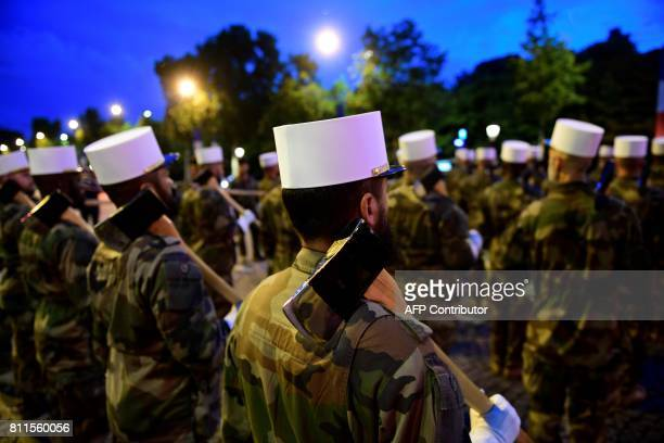 Soldiers from the Foreign Legion march down the Champs Elysees in Paris during a rehearsal of the annual Bastille Day military parade on July 10 2017...