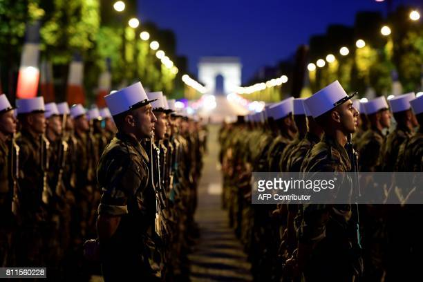 TOPSHOT Soldiers from the Foreign Legion march down the Champs Elysees with the Arc de Triomphe in the background in Paris during a rehearsal of the...