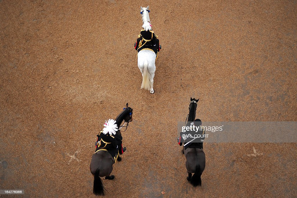 Soldiers from the Household Cavalry Mounted Regiment parade on Horse Guards in central London on March 22, 2013 during the Major General's inspection - a test which the unit has to pass in order to participate in state ceremonial duties in 2013. AFP PHOTO/CARL COURT