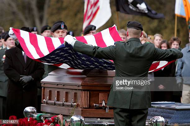 Soldiers from the Illinois National Guard remove the burial flag from the casket of Sgt Jessica Housby February 19 2005 in Rock Island Illinois Sgt...