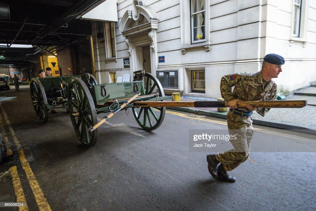 Soldiers from the King's Troop Royal Horse Artillery move the saluting guns in to position at Wellington Barracks ahead of their 70th anniversary parade on October 19, 2017 in London, England. Queen Elizabeth II will review the King's Troop Royal Horse Artillery to mark the 70th anniversary in Hyde Park today. 'The Troop' is a ceremonial mounted unit made up of 111 horses and a number of First World War state saluting guns which are fired during Royal Anniversaries and State Occasions.