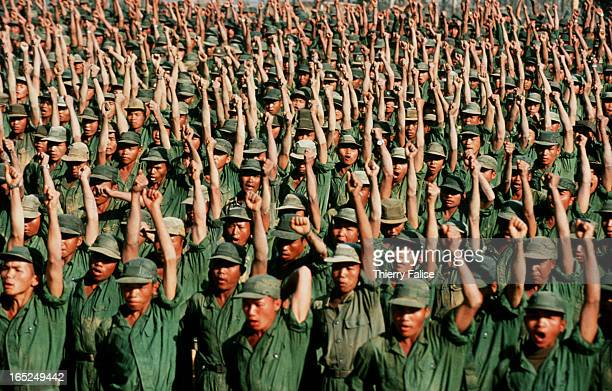 Soldiers from the Mong Tai Army belonging to drug warlord Khun Sa cheer for their commander during a morning gathering