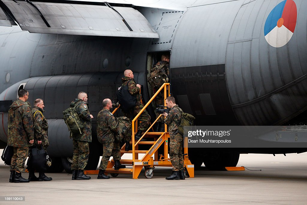 Soldiers from the Netherlands and Germany board the C-130 Hercules aeroplane to Turkey from Eindhoven Military Airport on January 8, 2013 in Eindhoven, Netherlands. This advance party of Dutch and German troops will fly to Turkey to prepare for the arrival of the Patriots with the main body of European soldiers arriving later in the month.