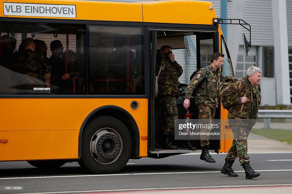 Soldiers from the Netherlands and Germany leave the transit bus for to board the C-130 Hercules aeroplane to Turkey from Eindhoven Military Airport on January 8, 2013 in Eindhoven, Netherlands. This advance party of Dutch and German troops will fly to Turkey to prepare for the arrival of the Patriots with the main body of European soldiers arriving later in the month.