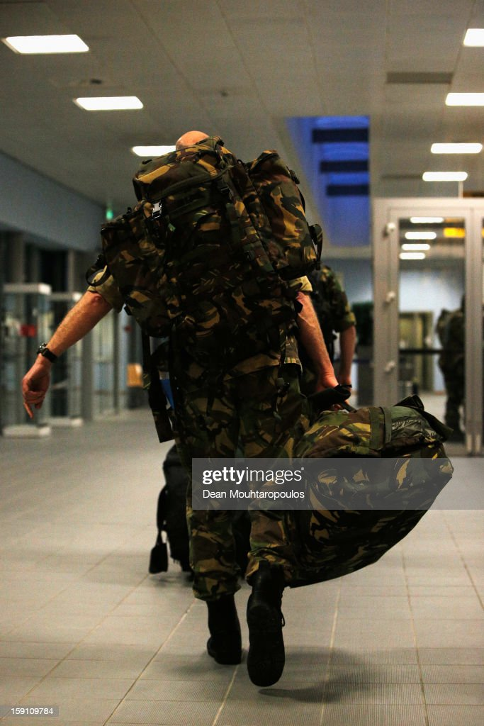 Soldiers from the Netherlands and Germany walk to the Airport check-in as they are transfered to Turkey from Eindhoven Military Airport on January 8, 2013 in Eindhoven, Netherlands. This advance party of Dutch and German troops will fly to Turkey to prepare for the arrival of the Patriots with the main body of European soldiers arriving later in the month.