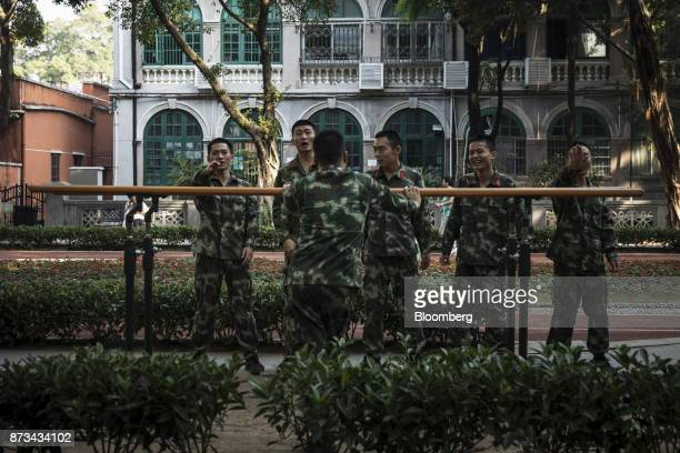 Soldiers from the People's Liberation Army react while performing exercises at a park in Shamian Island in Guangzhou China on Thursday Nov 2 2017...