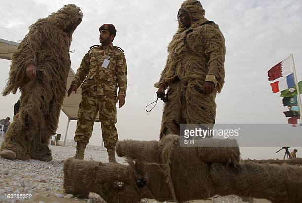 Soldiers from the Qatari army dressed in camouflage attend the final day of joint military exercises Gulf Falcon 2013 with the French armed forces in...