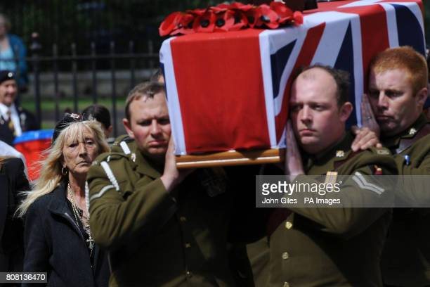 Soldiers from the Royal Dragoon Guards carry the coffin of Trooper Ashley Smith as his mother Sandra Smith wearing the regiment beret of the Royal...