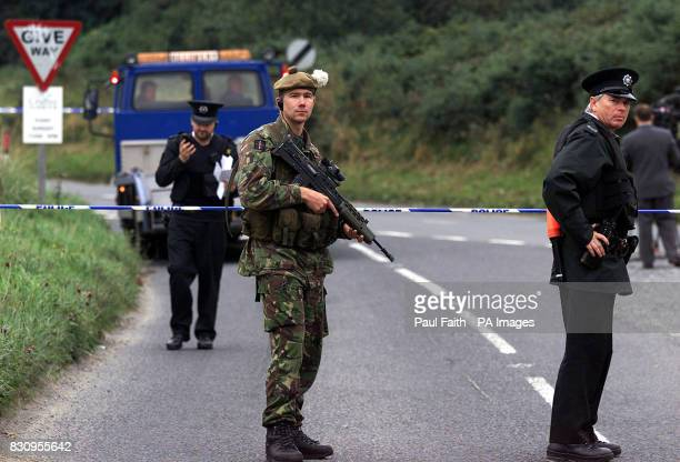 Soldiers from the Royal Highland Fusiliers and police seal off a border road near Newry Co Down where two unexploded undercar boobytrap bombs were...