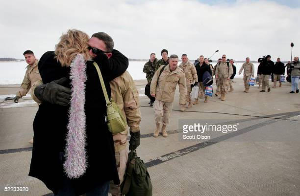 S soldiers from the US Army Reserve's 724th Transportation Company step off an aircraft after returning from duty in Iraq at Volk Field February 23...