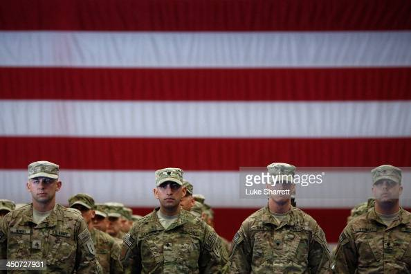Soldiers from the US Army's 3rd Brigade Combat Team 1st Infantry Division stand to attention while being introduced during a homecoming ceremony in...