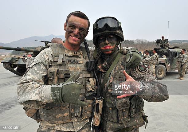 Soldiers from US and South Korea pose for a photo after a joint live fire exercise at a military training field in Pocheon northeast of Seoul on...