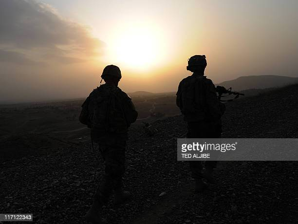 US soldiers from Viper Company 126 Infantry are seen during sunset as they conduct a patrol at Combat Outpost Sabari in Khost province in the east of...