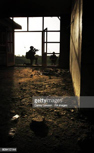 Soldiers from XRay Company 45 Commando Royal Marines at the building site of a new school in the village of Siadabad while on patrol from Patrol Base...