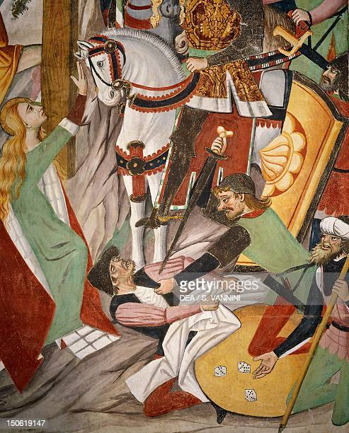 Soldiers gambling for Jesus' clothes by throwing dice detail from The Crucifixion fresco by Giovanni Canavesio in the NotreDame des Fontaines Chapel...