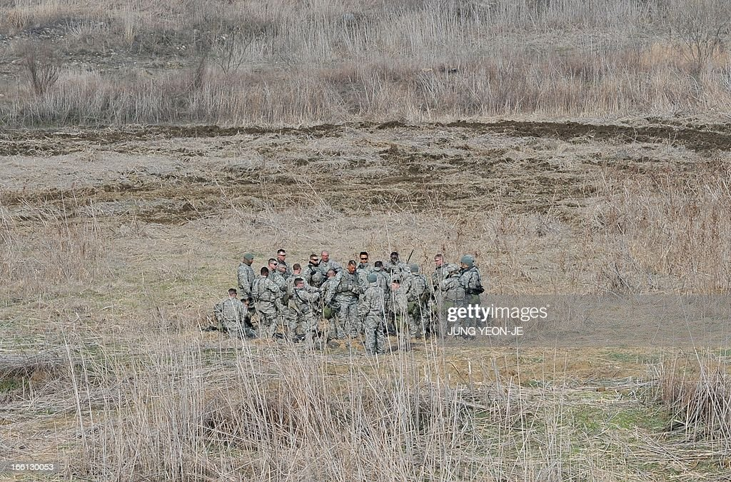 US soldiers gather at a military training field in the border city of Yeoncheon, northeast of Seoul, on April 9, 2013. North Korea said on April 9 the Korean peninsula was headed for 'thermo-nuclear' war and advised foreigners in South Korea to consider evacuation -- a warning that was largely greeted with indifference.