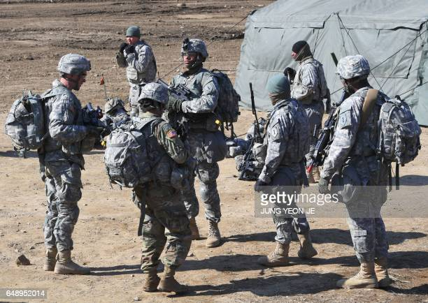 US soldiers gather during their drill at a military training field in the border city of Paju on March 7 2017 The US military has begun deploying the...