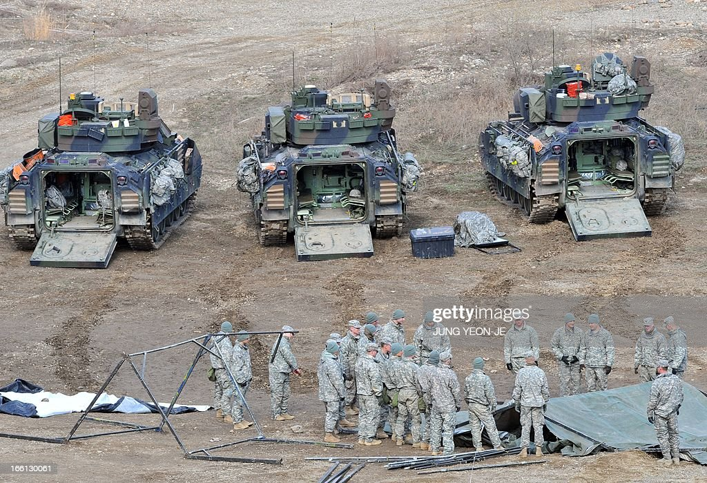 US soldiers gather near Bradley armored vehicles at a military training field in the border city of Yeoncheon, northeast of Seoul, on April 9, 2013. North Korea said on April 9 the Korean peninsula was headed for 'thermo-nuclear' war and advised foreigners in South Korea to consider evacuation -- a warning that was largely greeted with indifference.