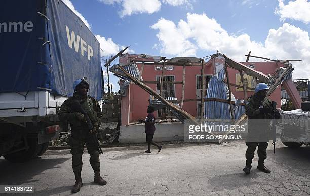 UN soldiers guard a truck with aid from the UN's World Food Programme in Port Salut southwest of PortauPrince on October 12 following the passage of...