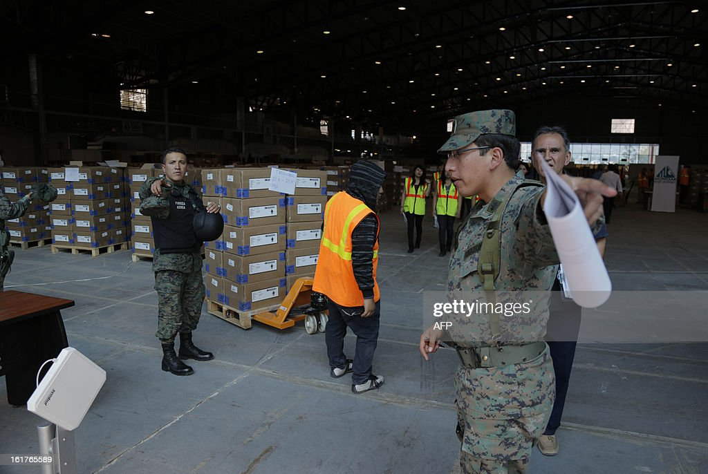 Soldiers guard electoral kits from the Ecuadorean Electoral National Council, before they are shipped for Sunday's national election, in Quito, on February 15, 2013. Ecuadoran President Rafael Correa is favored to cruise to a new term Sunday to cement a 'socialist revolution' that has brought stability to a nation where several leaders were forced out before him. An outspoken voice of the Latin American left and friend of ailing Venezuelan President Hugo Chavez, the charismatic, US-educated economist is far ahead of his seven rivals in all opinion polls after six years in office.