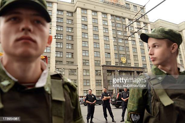 Soldiers guard in front of the State Duma in central Moscow on July 18 during a protest after opposition leader Alexei Navalny was sentenced to five...