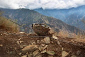 S soldier's helmet lies on a mountaintop position on September 2 2011 at Observation Post Mustang in Kunar Province Afghanistan The area in...