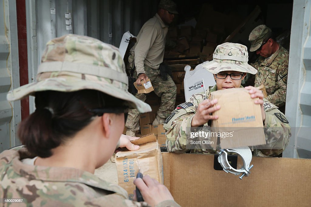 Soldiers help to fill a pallet with excess electrical connectors left by a departing unit as the U.S. continues draws down manpower in the 13-year-old war on March 22, 2014 near Gardez, Afghanistan. The connectors are slated to be sold for scrap. In the past year the U.S. Military has been reducing troops and equipment in Afghanistan as it transitions from a role of combatants, fighting alongside Afghan soldiers, to assisting the Afghan National Security Forces in an advisory role. President Obama recently ordered the Pentagon to develop a contingency plan for a complete pullout from Afghanistan by the end of 2014 if Afghanistan President Hamid Karzai or his successor refuses to sign the Bilateral Security Agreement.