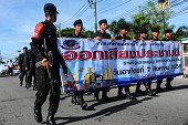 Soldiers hold banners as they march during a campaign encouraging the public to vote in the upcoming referendum on Thailand's draft constitution in...