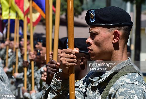 US soldiers hold flags during a South KoreaUS Combined Division activation ceremony at a US Army base in Uijeongbu just north of Seoul on June 3 2015...