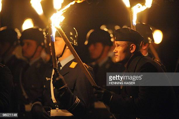 Soldiers hold torches during a Great Tattoo for the farewell of Chief of German Army Lt Gen and parting army inspector Hans Otto Budde in Bonn...