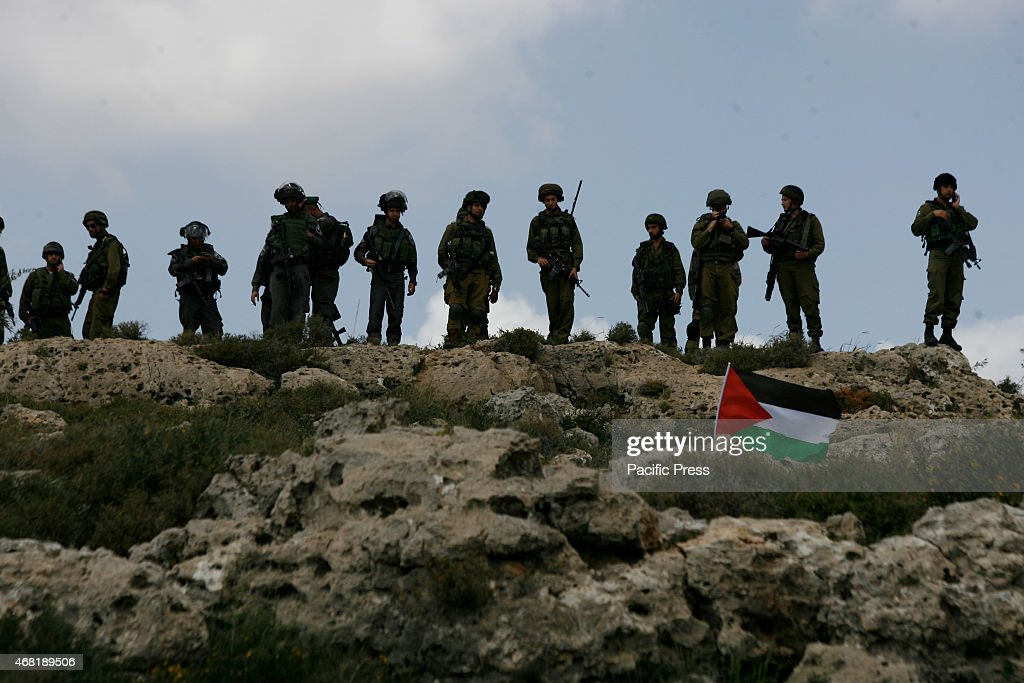 Soldiers in action during the Land Day as the Palestinian protesters hurl stones toward Israeli soldiers during a protest marking Land Day in Wadi...