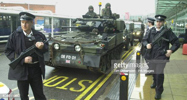 Soldiers in an armoured car stand guard in front of Terminal 2 at London's Heathrow airport Scotland Yard said that the troops had been moved in to...