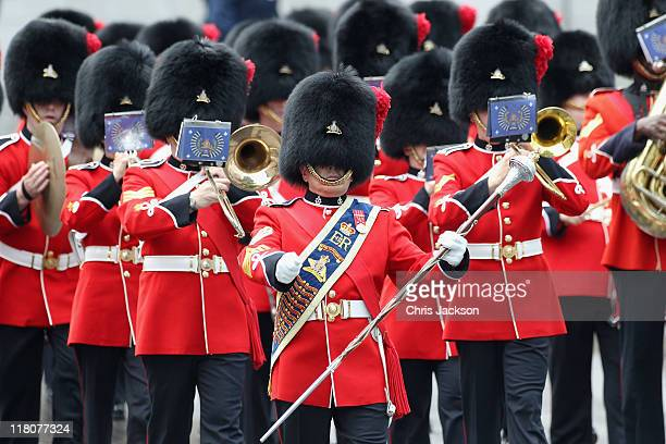 Soldiers in bearskins march at a Freedom of the City Ceremony outside City Hall on July 3 2011 in Quebec Canada The newly married Royal Couple are on...