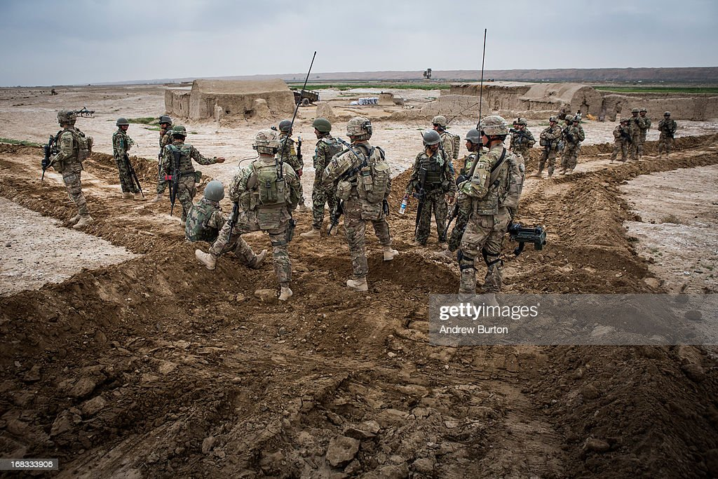 Soldiers in the Afghan National Army's 6th Kandak (battalion), 3rd company participate in a joint patrol with the U.S. Army's 1st Battalion, 36th Infantry Regiment near Command Outpost Pa'in Kalay on April 6, 2013 in Kandahar Province, Maiwand District, Afghanistan. The United States military and its allies are in the midst of training and transitioning power to the Afghan National Security Forces in order to withdraw from the country by 2014.
