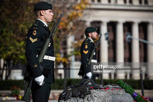 Soldiers in the Canadian Army stand guard at the National War Memorial during a ceremony at the memorial on October 24 2014 in Ottawa Canada Two days...