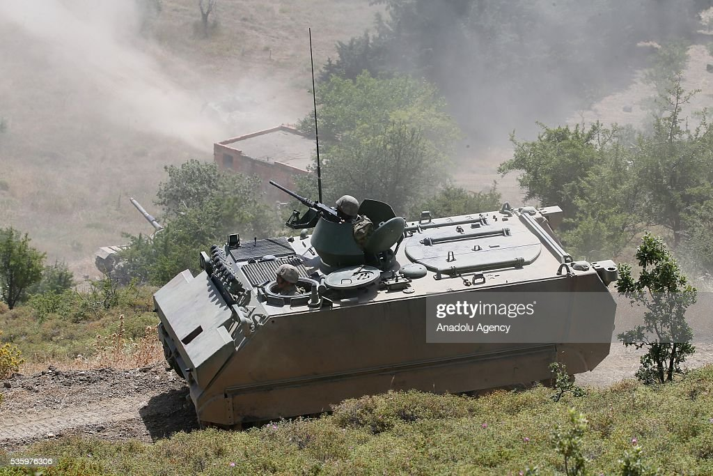 Soldiers inside armored vehicle are in action during the Efes-2016 Combined Joint Live Fire Exercise at Seferihisar district of Izmir, Turkey on May 31, 2016. The Turkish-led multinational military exercises, Efes-2016 which started at 04 May and will be finished at 04 June 2016, aims to train participating units and staff in planning and conducting combined and joint operations, including logistics and command-control as well as to improve the level of interoperability among headquarters and forces.