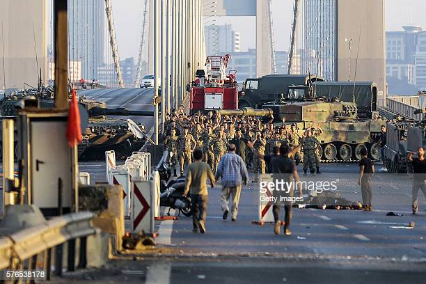 Soldiers involved in the coup attempt surrender on Bosphorus bridge with their hands raised on July 16 2016 in Istanbul Turkey Istanbul's bridges...
