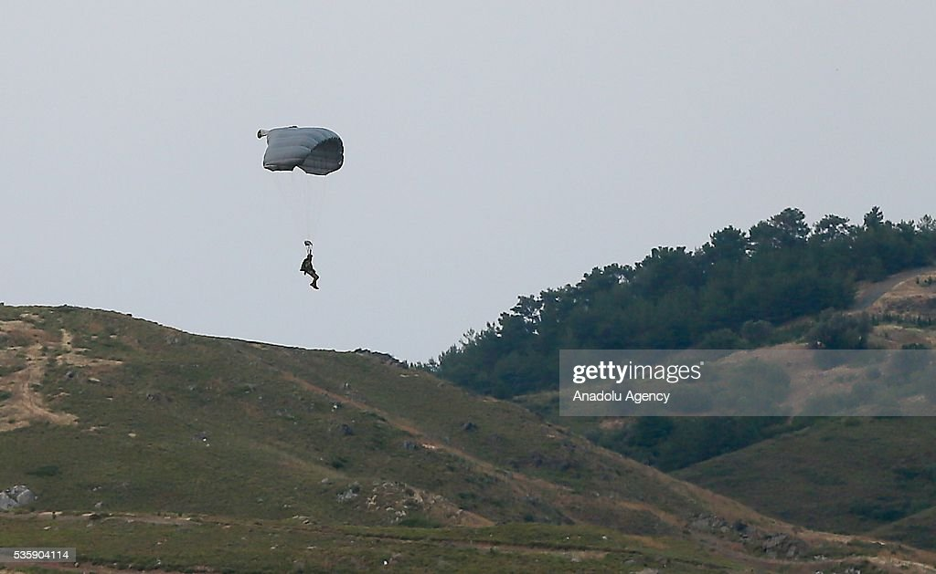 Soldiers jump out of an airplane with their parachutes during the Efes-2016 Combined Joint Live Fire Exercise at Seferihisar district of Izmir, Turkey on May 30, 2016. The Turkish-led multinational military exercises, Efes-2016 which started at 04 May and will be finished at 04 June 2016, aims to train participating units and staff in planning and conducting combined and joint operations, including logistics and command-control as well as to improve the level of interoperability among headquarters and forces.