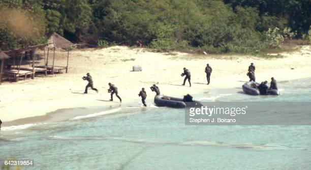 SATTAHIP CHONBURI THAILAND Soldiers land with an amphibious assault boats and secure the beach head during the ongoing USThai joint military exercise...