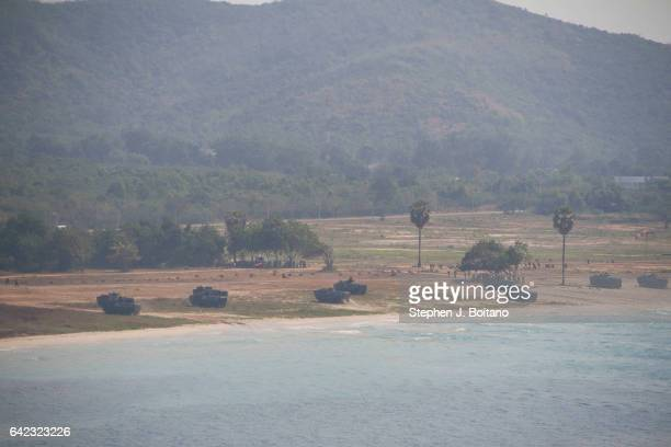 SATTAHIP CHONBURI THAILAND Soldiers land with an amphibious assault vehicles and secure the beach head during the ongoing USThai joint military...
