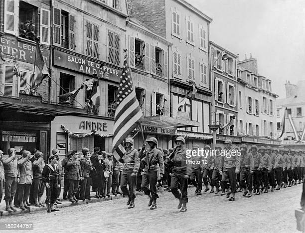 US soldiers lead a parade in Cherbourg held in honor of French patriots killed during the German occupation
