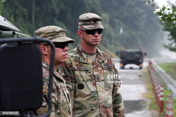 US soldiers look on during Warrior Strike VIII a bilateral training exercise between the US Army's 2nd Armored Brigade Combat Team 1st Cavalry...