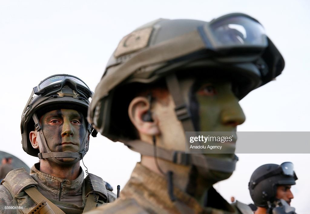 Soldiers make their last preparations during the Efes-2016 Combined Joint Live Fire Exercise at Seferihisar district of Izmir, Turkey on May 30, 2016. The Turkish-led multinational military exercises, Efes-2016 which started at 04 May and will be finished at 04 June 2016, aims to train participating units and staff in planning and conducting combined and joint operations, including logistics and command-control as well as to improve the level of interoperability among headquarters and forces.
