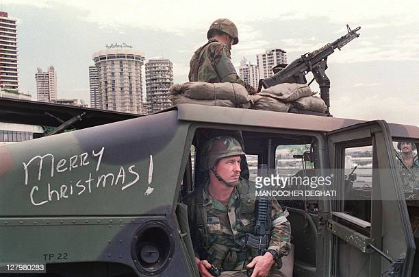 US soldiers man their security position outside the Vatican embassy in Panama City where Panamanian General Manuel Noriega is seeking asylum during...