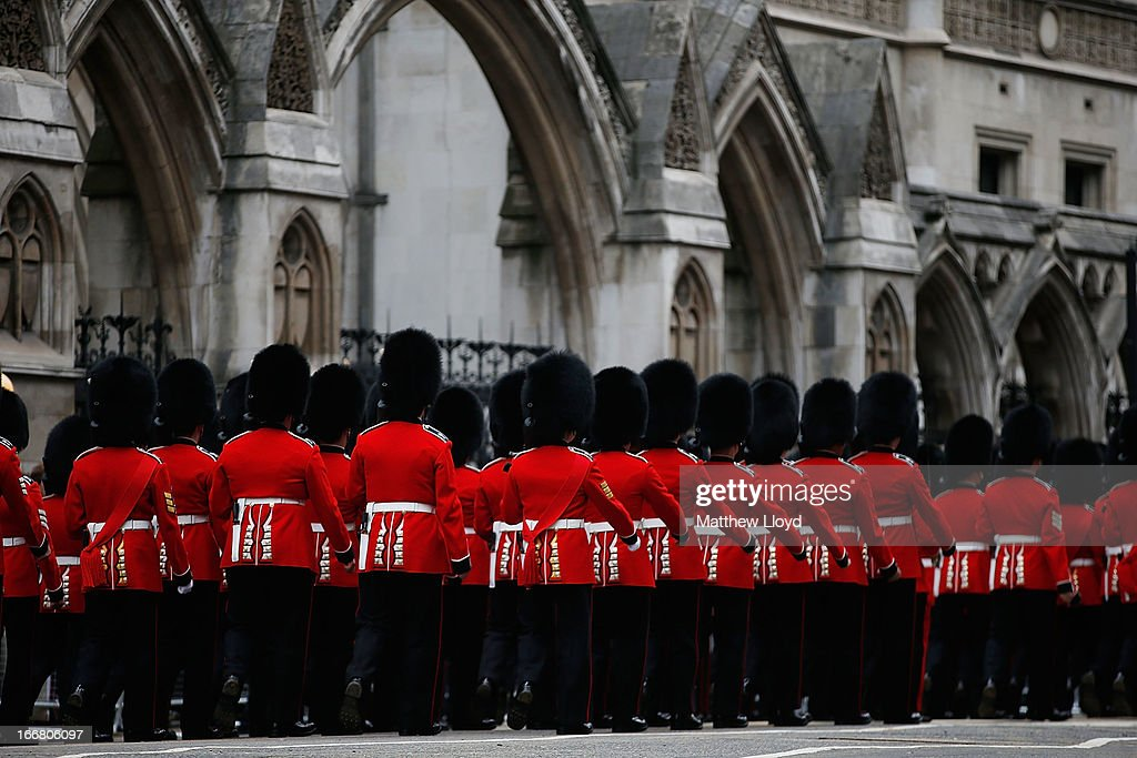 Soldiers march along Fleet Street before the funeral cortege of former British Prime Minister Baroness Thatcher passes by the Royal Courts of Justice...