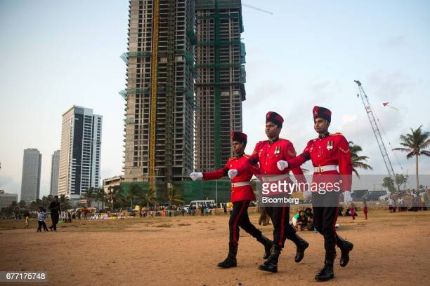 Soldiers march at Galle Face Green as the under construction ShangriLa Hotel Colombo stands in the background in Colombo Sri Lanka on Friday April 21...
