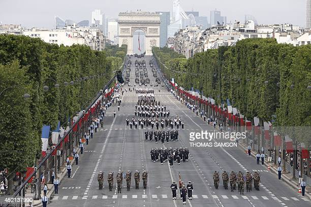 Soldiers march down the ChampsElysees avenue during the annual Bastille Day military parade in Paris on July 14 2014 AFP PHOTO / POOL / THOMAS SAMSON